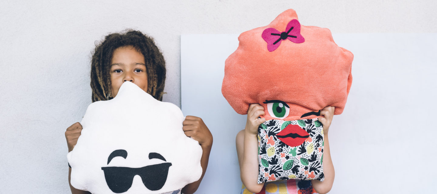 Photography, two kids holding pillows